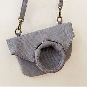 Anthropologie ring fold grey cross body bag clutch